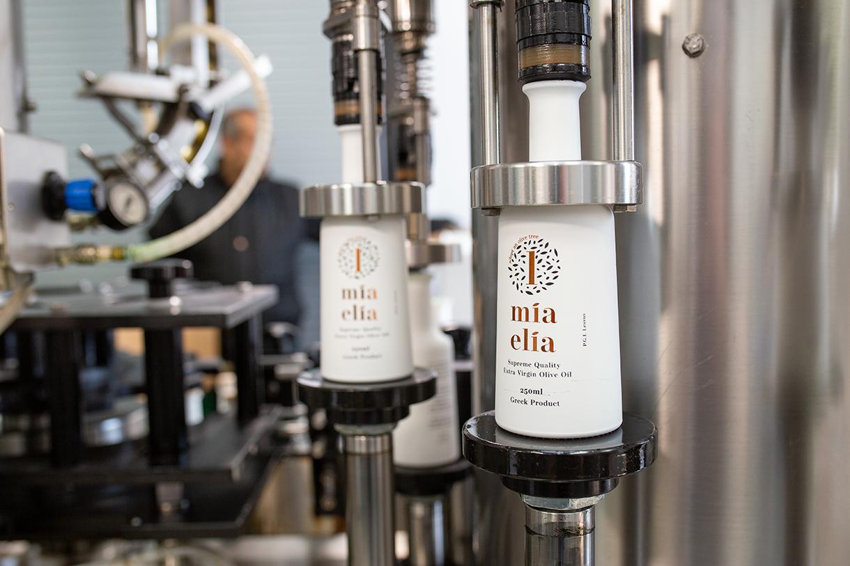 Olive oil bottle filler